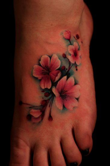 small foot cherry blossom tattoo of flowers in bloom. Black Bedroom Furniture Sets. Home Design Ideas