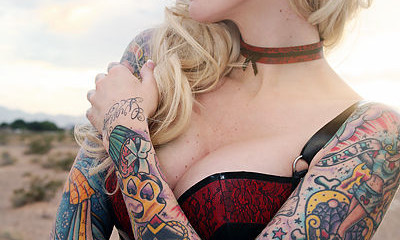 Girls colorful full sleeve tattoos w/ just about everything
